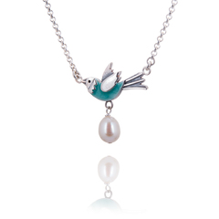 Pale Blue Enamel Flying Bird with Pearl Egg