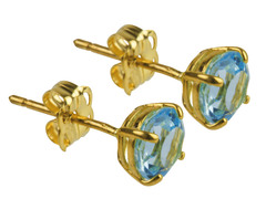 Solid gold and blue topaz studs