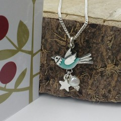 Aqua blue flying bird pendant