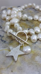 White freshwater pearl and hammered Star necklace