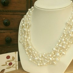 Six strand natural white freshwater and seed pearl necklace