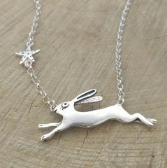 Large hare chasing star pendant